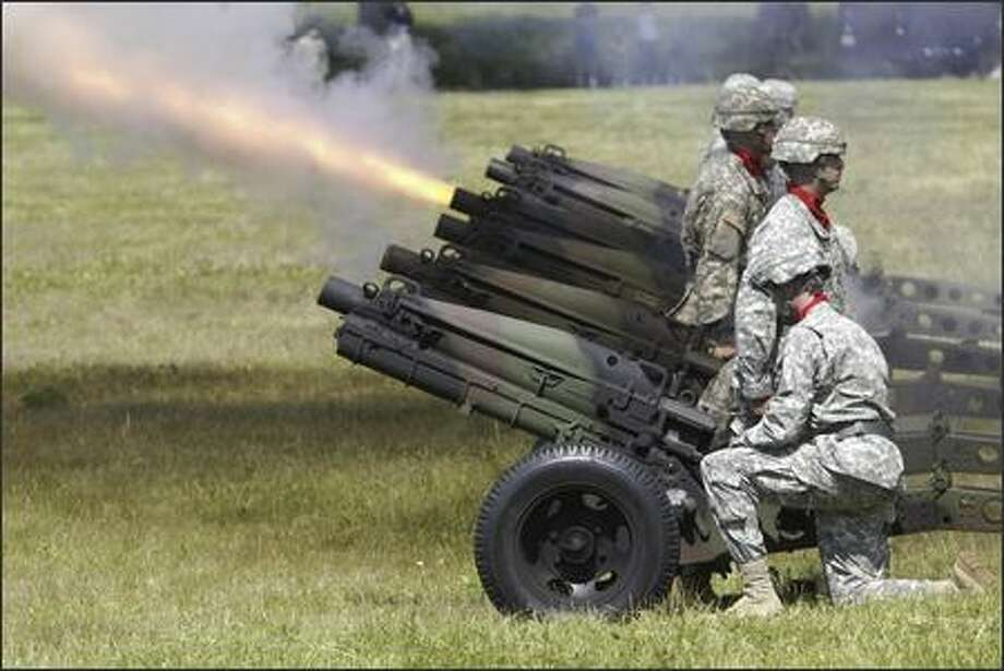 Cannons fire during a change-of-command ceremony at Fort Lawton. Photo: Jim Bryant, Seattle Post-Intelligencer / Seattle Post-Intelligencer