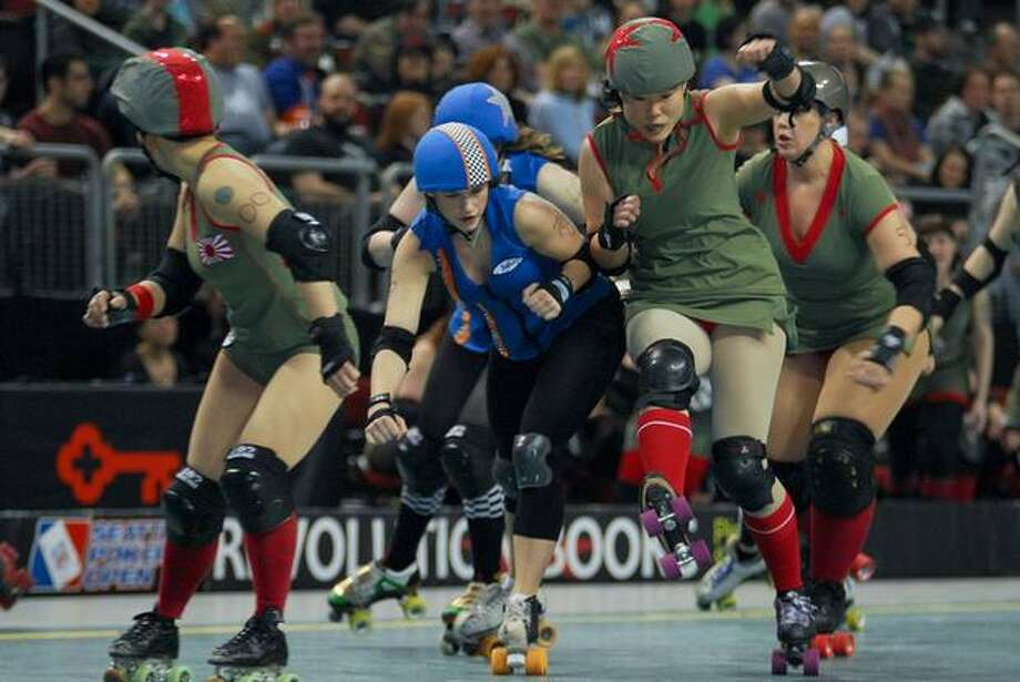 "A May 1 roller derby ""bout"" at KeyArena. (Photo by Chris Jones)"