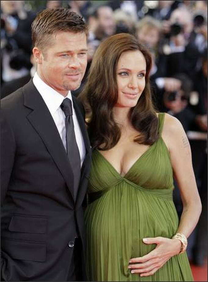 "Brad Pitt, left, and Angelina Jolie arrive for the premiere of the film ""Kung Fu Panda,"" on May 15 during the 61st International film festival in Cannes, France. Photo: Associated Press / Associated Press"