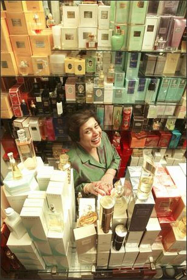 Nasreen Rehmat, owner of Parfumerie Nasreen in the Alexis Hotel, stocks 780 scents in her 300-square-foot store. She's been in the business for 20 years and has a knack for selecting the right scent for her clients. Photo: Mike Urban, Seattle Post-Intelligencer / Seattle Post-Intelligencer