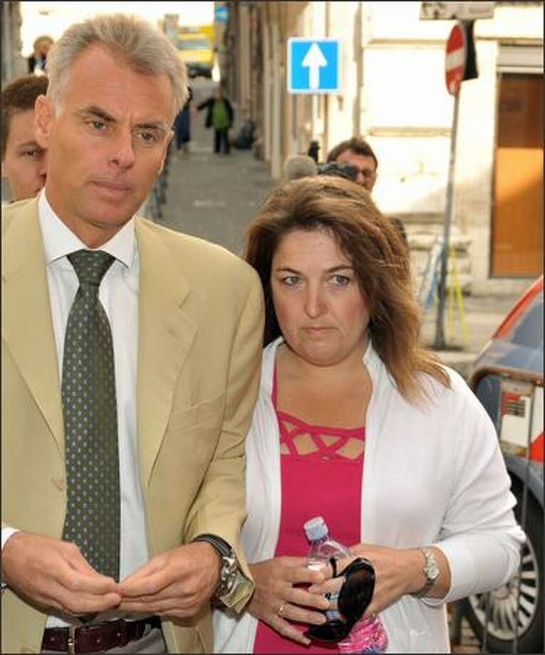 Carlo Della Vedova, left, the lawyer for murder suspect Amanda Knox, walks with an unidentified relative of the Knox family to Saturday's hearing in Perugia. Photo: Associated Press / Associated Press