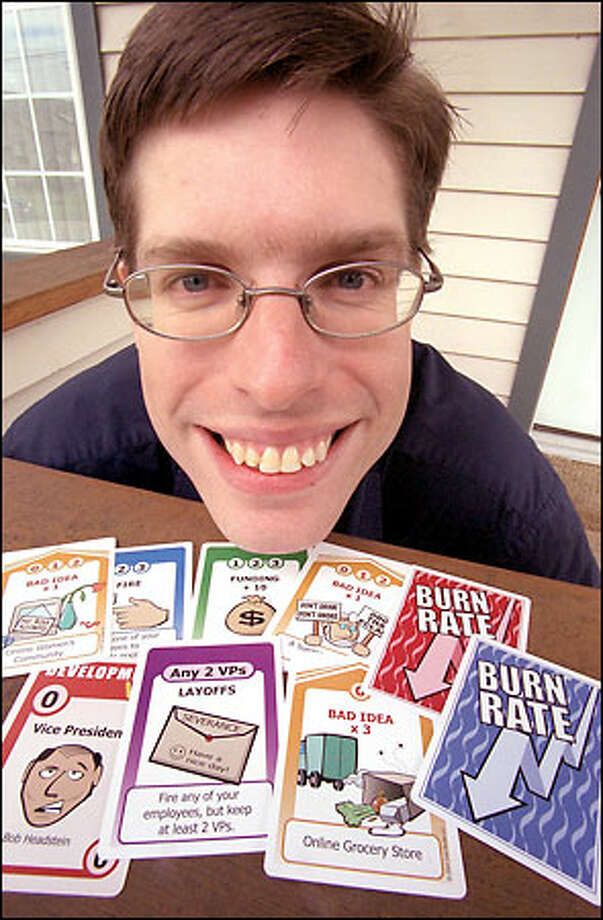 Game fancier Rich Koehler, president of www.cool-studio.net, with Burn Rate cards at his West Seattle home. Photo: Phil H. Webber, Seattle Post-Intelligencer / Seattle Post-Intelligencer