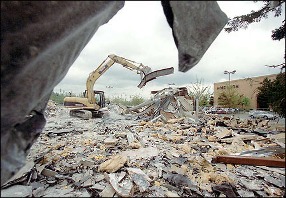 The last wall of the Lamonts store at the Alderwood Mall was torn down this week to make room for a new Nordstrom store. The old Nordstrom, background, will be razed. Photo: Phil H. Webber, Seattle Post-Intelligencer / Seattle Post-Intelligencer