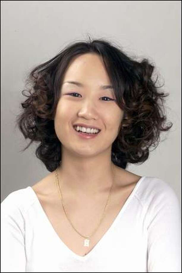 Hye-Jin Lee, a student at the University of Washington, has naturally thick, wavy hair. She had been wearing it with curls but wanted to try something new. Photo: Grant M. Haller, Seattle Post-Intelligencer / Seattle Post-Intelligencer