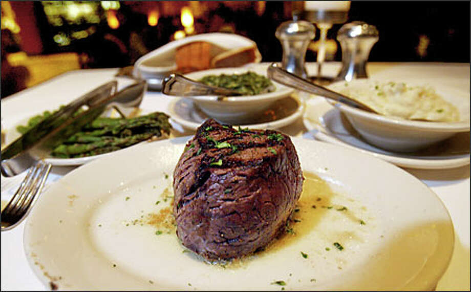 From Ruth's Chris Steak House: A picture-perfect order of filet mignon with asparagus, creamed spinach and garlic mashed potatoes. But dinner there proves far from perfect. Photo: Scott Eklund, Seattle Post-Intelligencer / Seattle Post-Intelligencer
