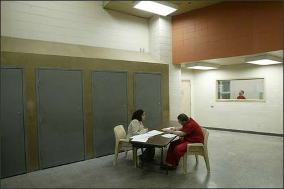 """Several on Yelp weighed in on King County Jail, giving it an average 1.5 stars. Here's one dissatisfied guest:""""I was a guest at the King County Bed and Breakfast in 2001.   Not the most welcoming place I have ever visited. Both the bed and the breakfast were well under par. Why my rectum needed to be inspected before I was offered my lovely jumpsuit and plastic sandals is beyond me.   I shan't return."""" Photo: Mike Urban, Seattle Post-Intelligencer / Seattle Post-Intelligencer"""