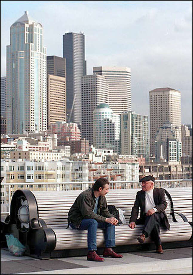 Tradition in a modern city: The dramatic skyline view of modern Seattle from the waterfront's historic Pier 66, also know as the Bell Street Pier. Pier 66 became the city's first pier when it opened in 1914 at the foot of Blanchard and Bell streets. Photo: Robin Layton, Seattle Post-Intelligencer / Seattle Post-Intelligencer