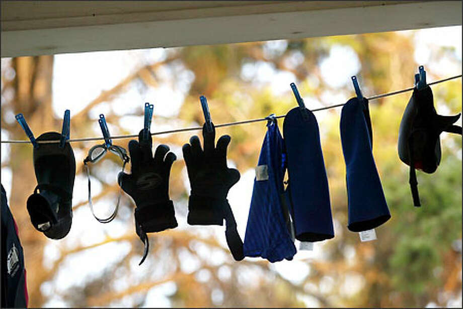 Swim gear dries on a friend's porch in The Dalles. The gloves are the only gear to survive the trip so far. Photo: Mike Urban, Seattle Post-Intelligencer / Seattle Post-Intelligencer