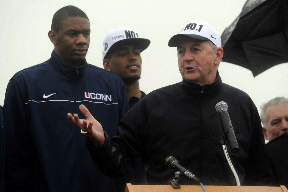 University of Connecticut men's basketball coach Jim Calhoun speaks to a small crowd which braved cold temperature, wind and rain to attend a welcome ceremony for the NCAA champion team at Bradley International Airport on Tuesday, April 5, 2011. Photo: Lindsay Niegelberg / Connecticut Post