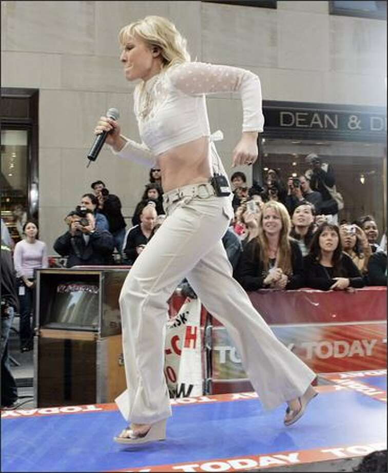 "Women sprinting in platform heels on runways frequently come to grief, but not this time. British pop singer Natasha Bedingfield defies the laws of gravity as she hustles back to the main stage for a performance on NBC's ""Today"" show in New York City's Rockefeller Center Friday. Bedingfield is a big deal in Europe but less known here, which she hopes to change. Photo: Associated Press / Associated Press"
