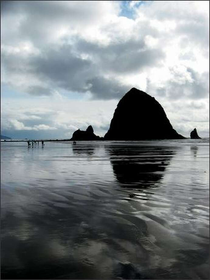 Picturesque Haystack Rock dominates the view at Cannon Beach. (LESLIE KELLY)