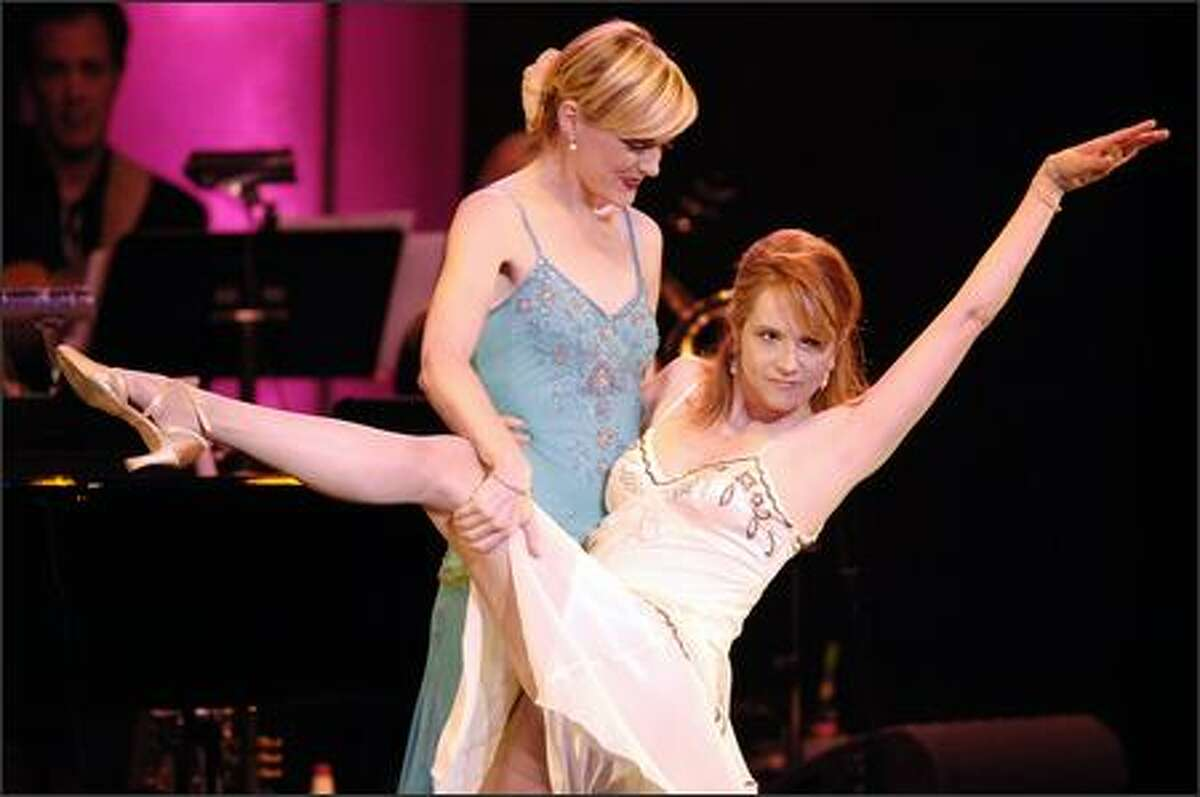 Lift a shapely leg for breast cancer research. Actresses Elaine Hendrix, left, and Lea Thompson perform together during the