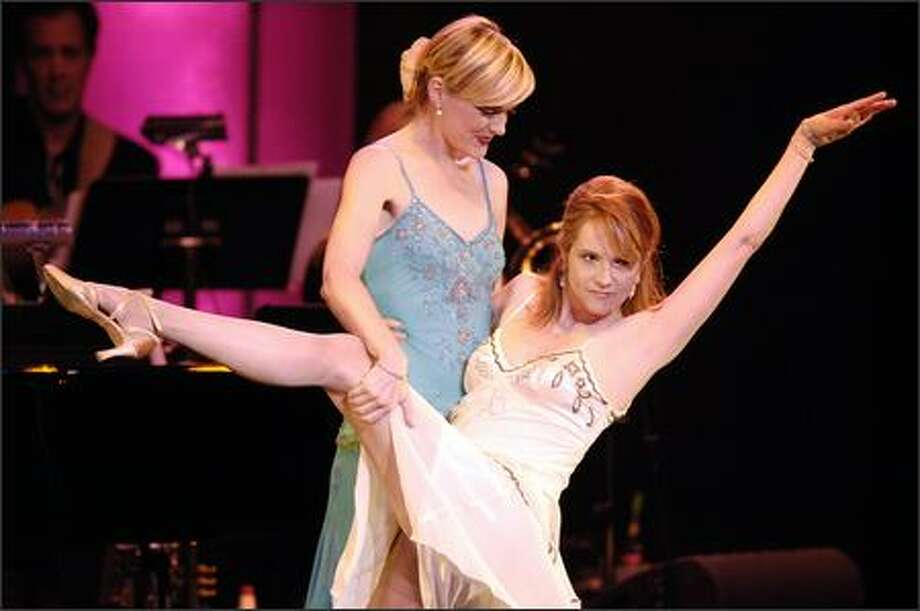 "Lift a shapely leg for breast cancer research. Actresses Elaine Hendrix, left, and Lea Thompson perform together during the ""What a Pair! 4"" concert at the Wiltern/LG Theater in Los Angeles on Sunday. The fourth annual concert featured celebrity women performing Broadway songs, to raise money for cancer research. Photo: Associated Press / Associated Press"