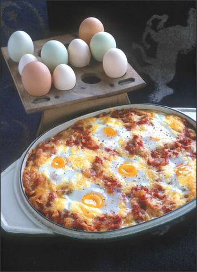 "Eggs are cooked on a bed of tomato sauce and cheese for 15-20 minutes in Frontier Eggs from ""Big Sky Cooking."""
