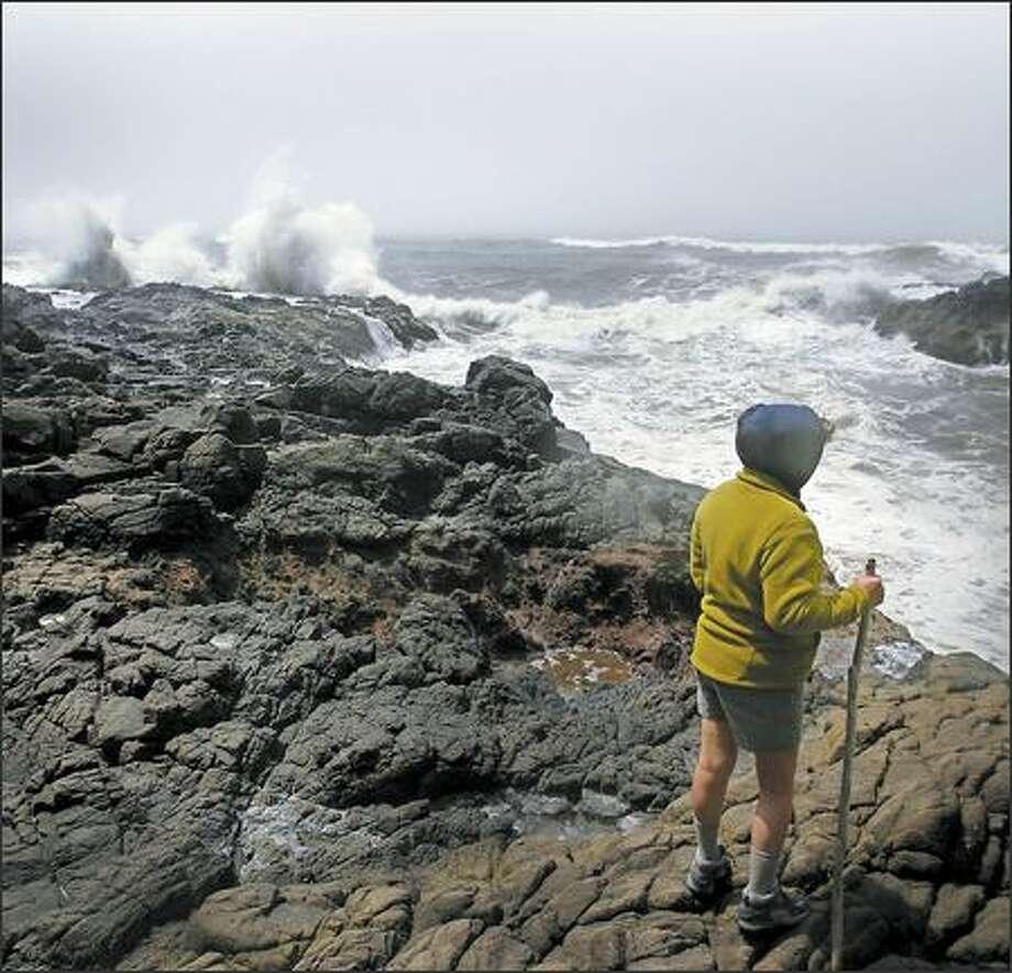 Laurie Jorgenson of Kirkland watches the water roil in Devil's Churn at Cape Perpetua on the Oregon coast. Photo: Joshua Trujillo, Seattlepi.com / seattlepi.com