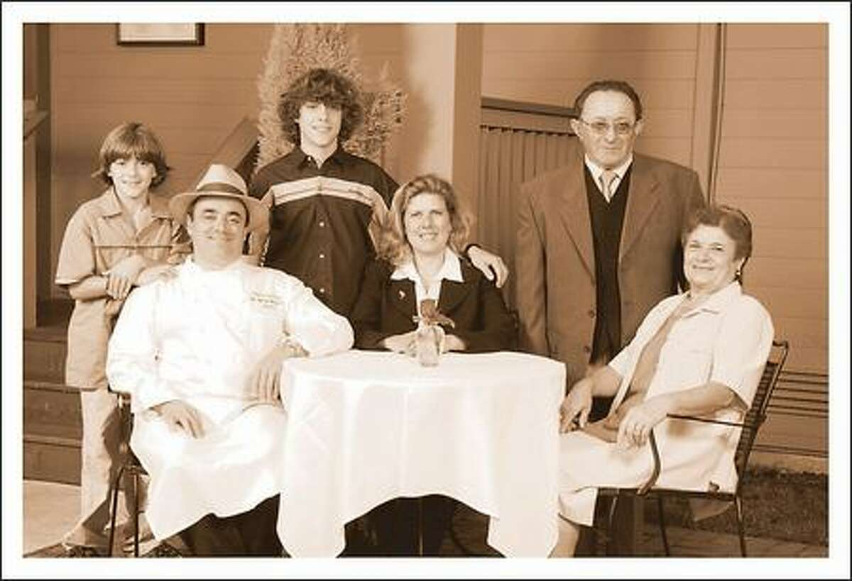 Papa Luc, second from right, is shown in this family photo taken at Rover's last year, along Rautureau, his sons, his wife, and his mother.