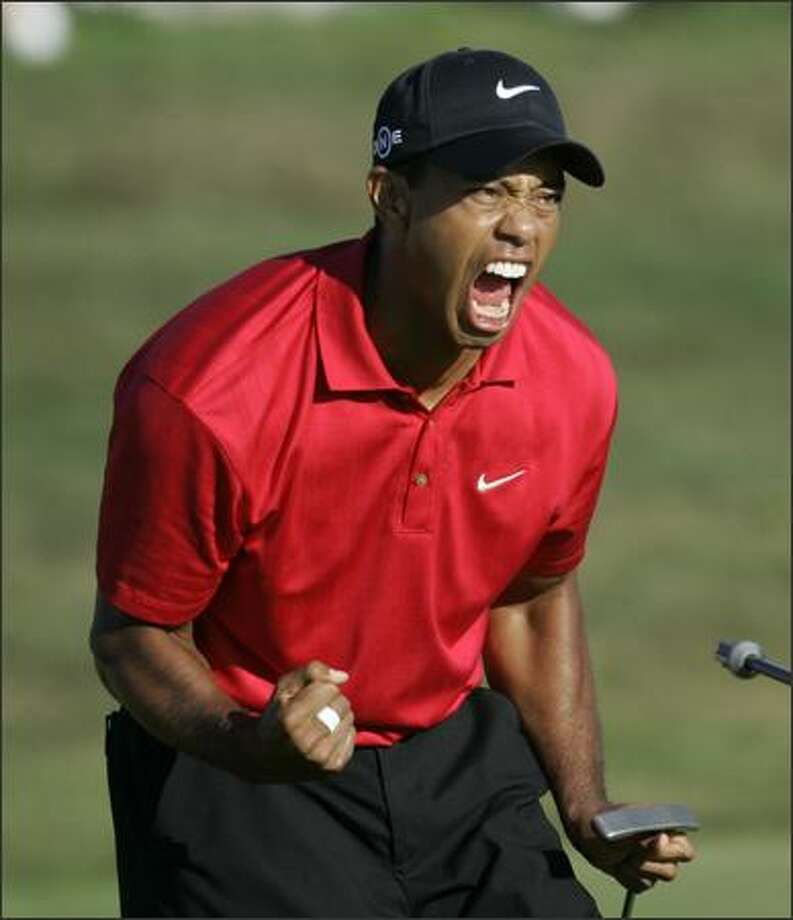 Tiger Woods reacts after sinking a birdie putt on the 18th green forcing a playoff against Rocco Mediate during the fourth round of the U.S. Open championship at Torrey Pines Golf Course in San Diego on Sunday. The 18-hole playoff will be Monday. Photo: Associated Press / Associated Press
