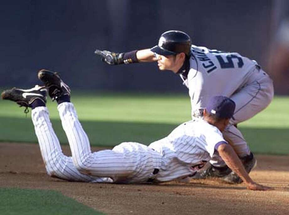 San Diego Padres second baseman Cesar Crespo, on the ground, unsuccessfully tries to tag out Ichiro Suzuki after Ichiro stole second base in the first inning Photo: Associated Press / Associated Press