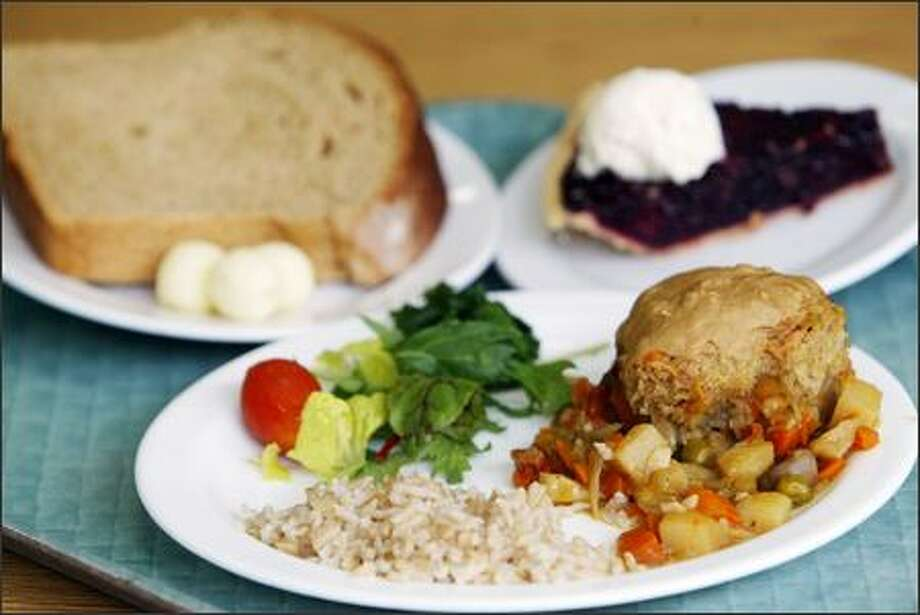 Vegetable Pot Pie (made fresh in house), rice and greens served alongside oatmeal bread and vegan marionberry pie is offered one day last week at the public-friendly Bastyr University cafeteria. Photo: Joshua Trujillo, Seattlepi.com / seattlepi.com
