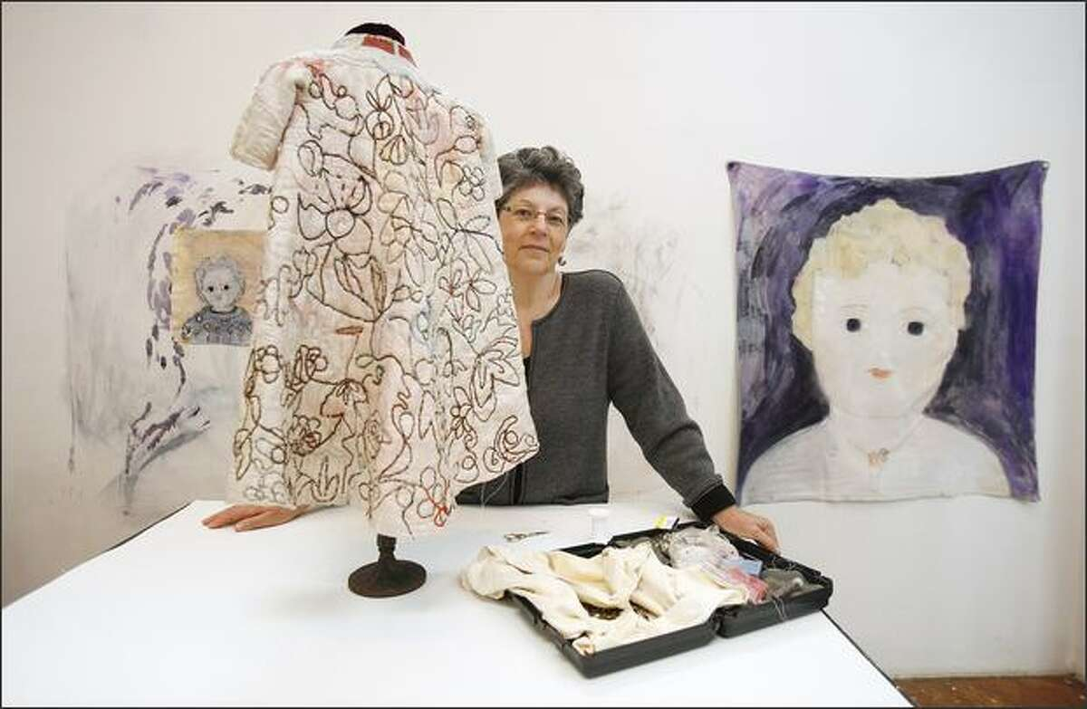 Sherry Markovitz with one of her works in progress at her South Seattle studio. Her sculptures and paintings are labor intensive, but the labor doesn't show.