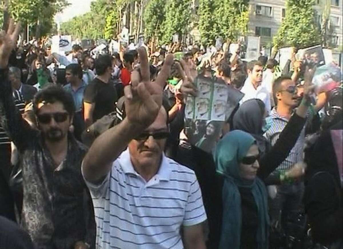 In this frame grab taken from amateur video, supporters of Iranian reformist opposition leader Mir Hossien Mousavi demonstrate Tuesday in Tehran, Iran. Thousands of protesters rallied in Tehran in support of Mousavi, according to witnesses and video footage. (AP Photo/APTN, Amateur Video)