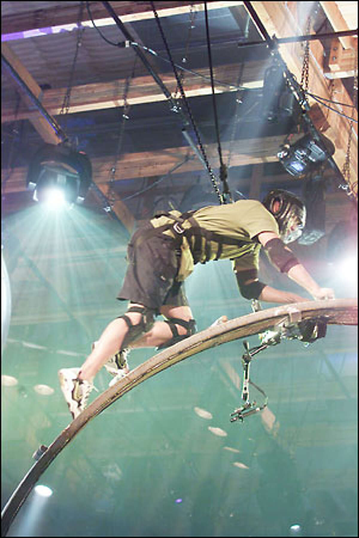 A contestant mounts the Ladder Wheel, one of the combined physical-mental challenges on NBC's