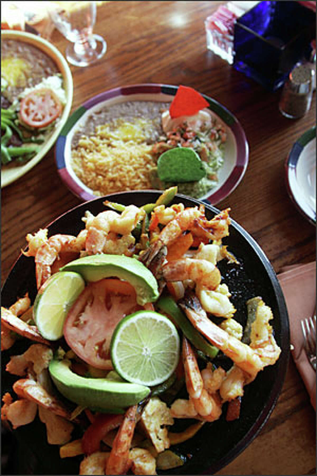 Cuervo Gold Fajitas and carne asada are two of the best-selling dishes at Torero's Belltown, the newest branch of the Rodriguez family's local chain.