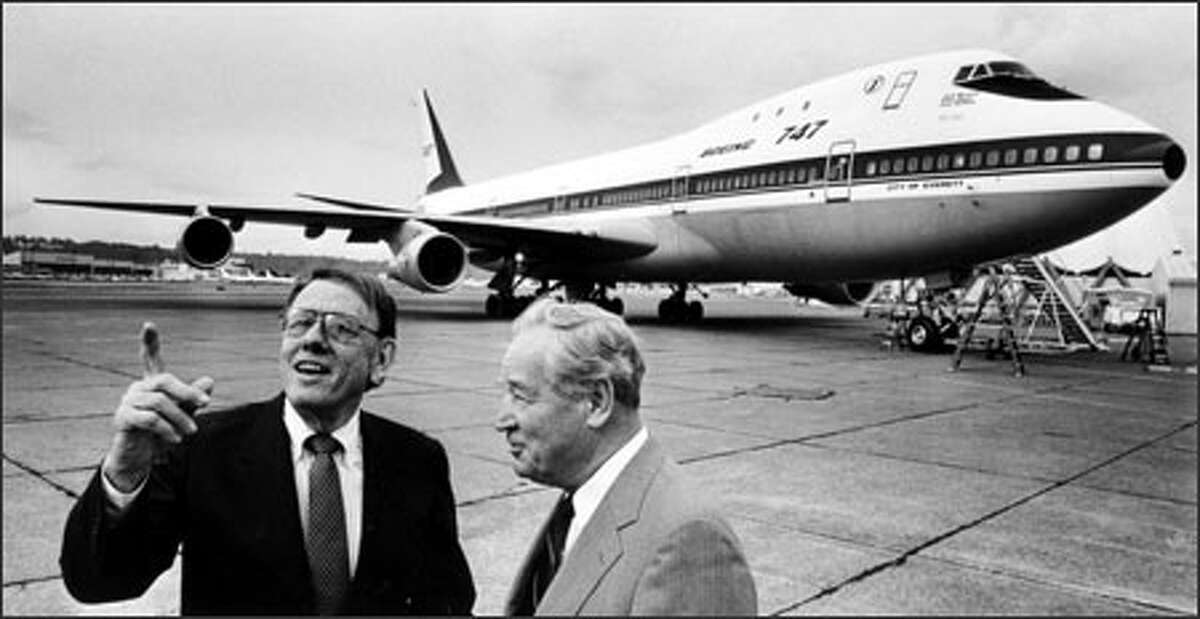 Boeing executives Malcolm Stamper, left, and Joe Sutter show off the first Boeing 747 after working together on producing the jumbo plane.