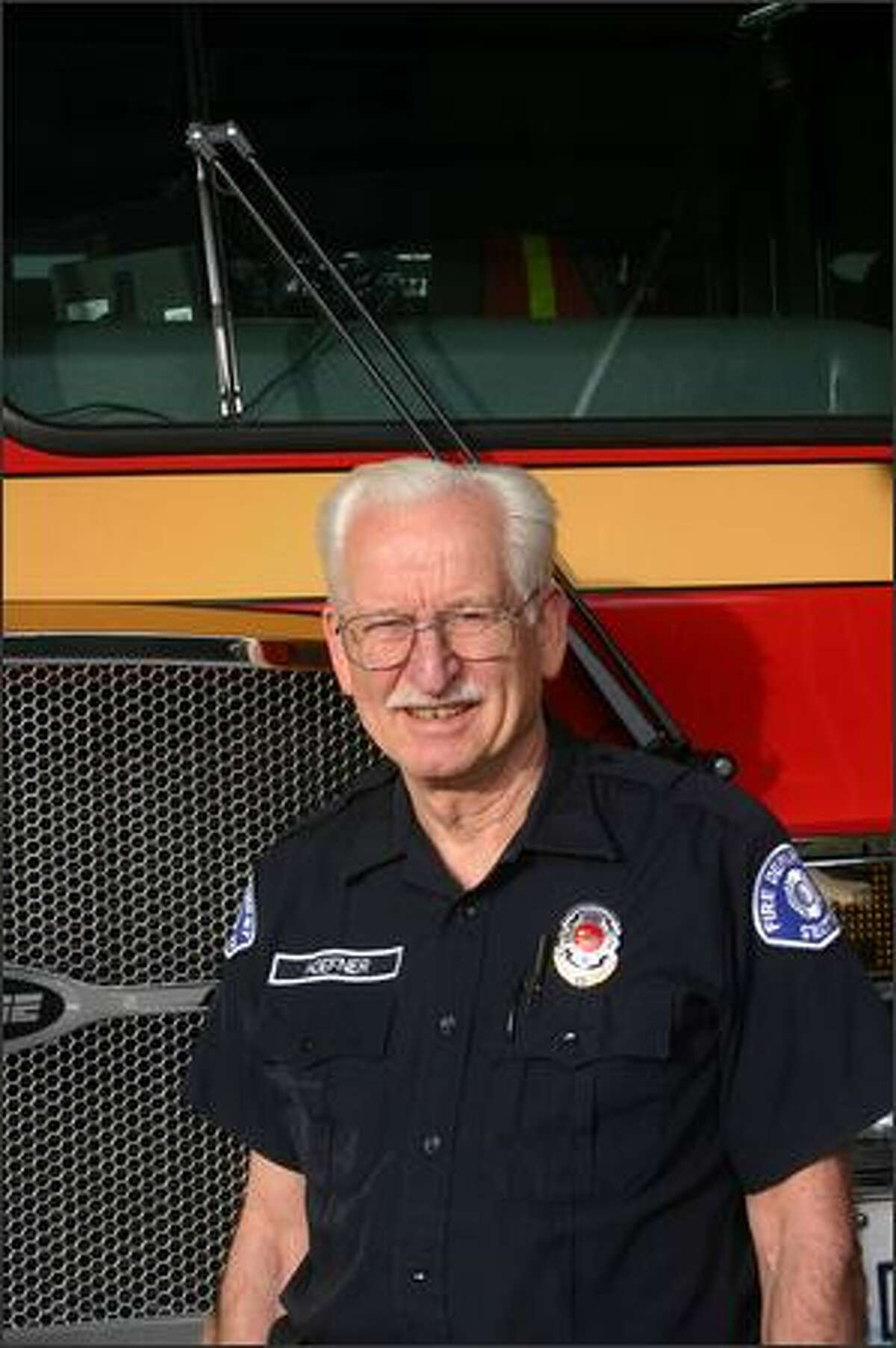 Ken Hoefner, at age 70 the Seattle Fire Department's oldest firefighter, says,