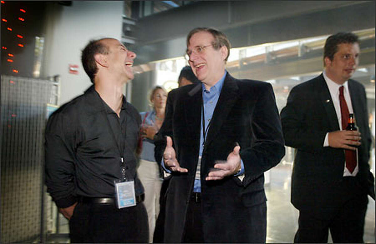 Paul Allen, right, laughs with Amazon.com founder Jeff Bezos during the VIP Opening Night event for the new Science Fiction Museum and Hall of Fame.