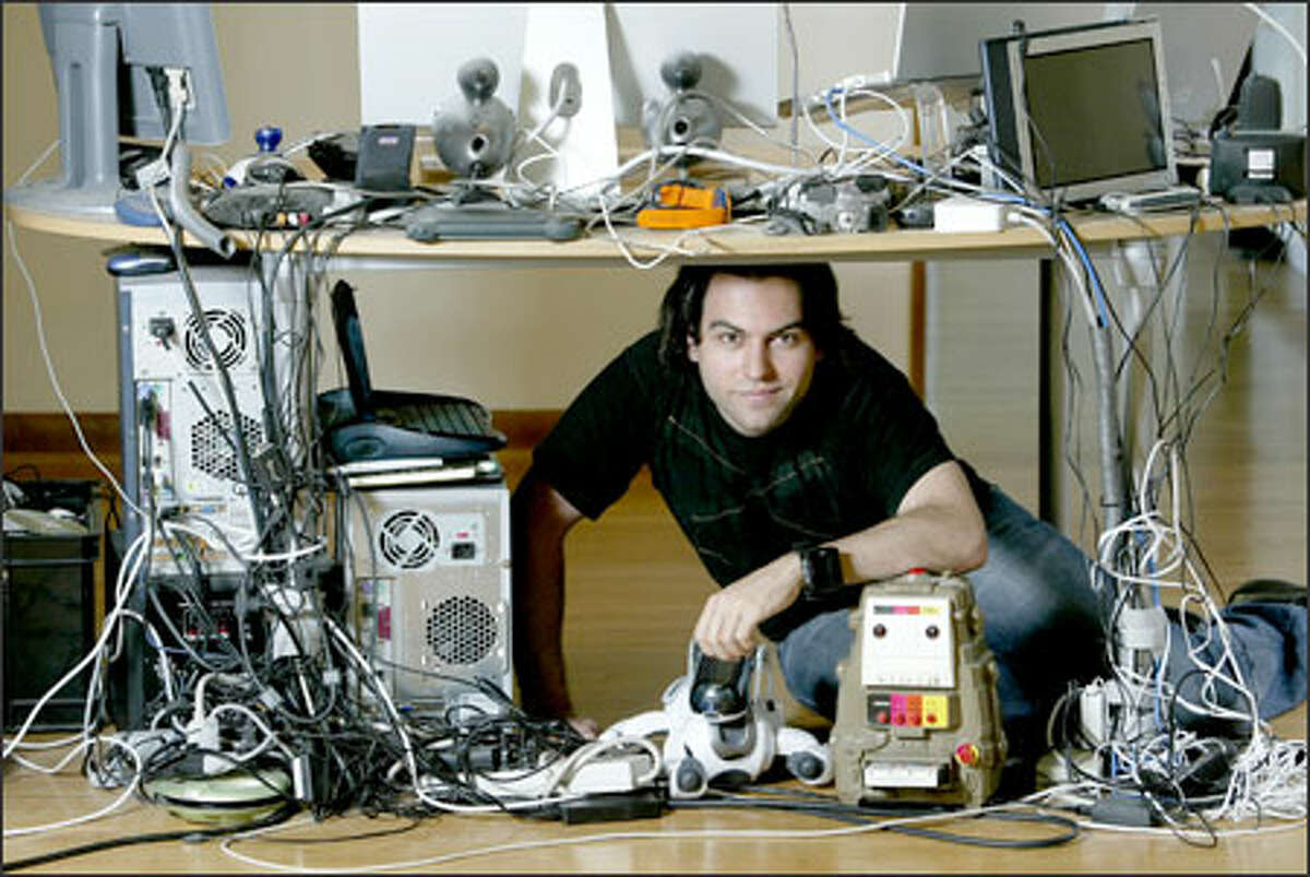 Phil Torrone, associate editor of Make magazine, spends a lot of his time rerouting wires beneath the dining room table at his Wallingford home.