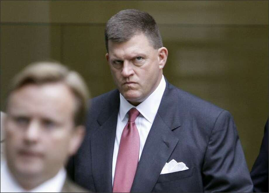 Seattle SuperSonics owner Clay Bennett, right, arrives at the U.S. Courthouse in downtown Seattle to testify in the city's trial against the team on Tuesday. Photo: Associated Press / Associated Press