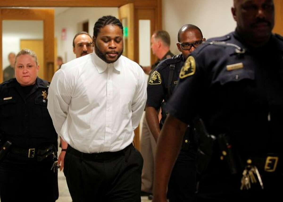 Omar Ali Norman leaves the courtroom during a recess June 11. Norman was convicted Thursday in the October 2005 slaying of a leader of a rival Seattle street gang.