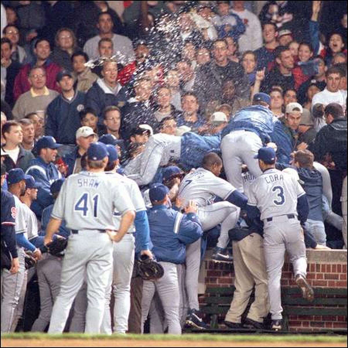 Dodgers players charge into the Wrigley Field stands during a 2000 game against the Cubs. Incidents of unruly fans acting out on their anger seem more prevalent in the age of multimillion-dollar salaries.