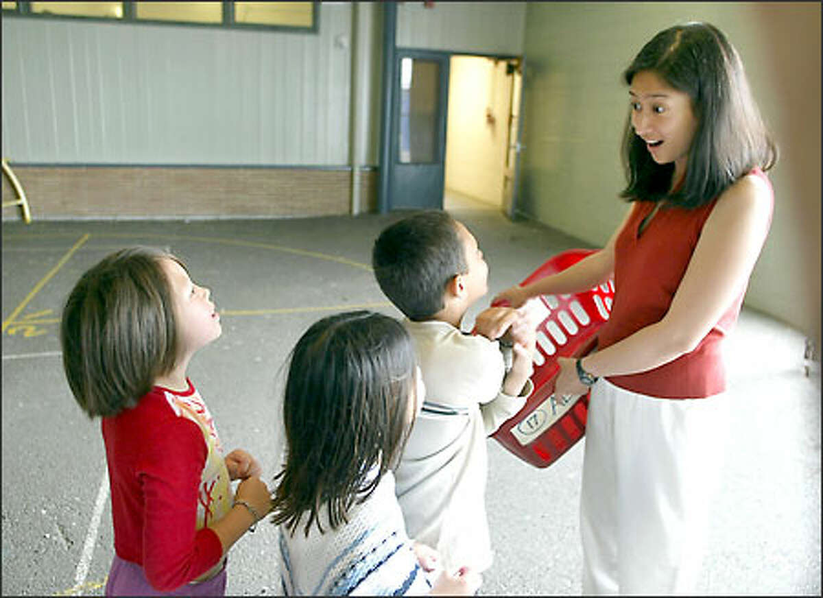 Second-grade teacher Vivienne Alcantara reacts to her pupils on her last day of school. After her first year teaching at Arbor Heights Elementary School, she was laid off.
