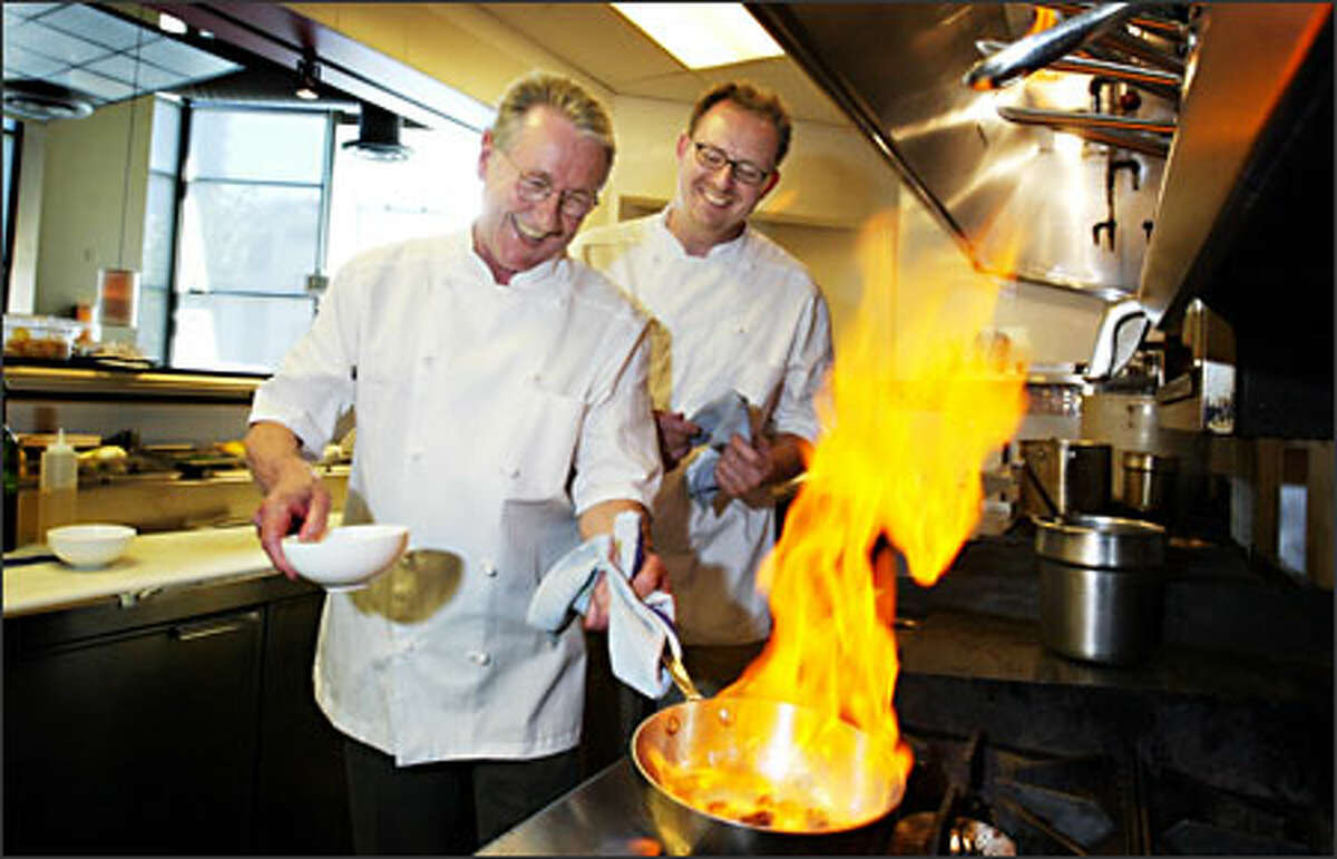 Pacific Northwest Ballet artistic director -- and super home cook -- Kent Stowell, left, gets a lesson in restaurant cooking from his son, Ethan, at Ethan's Union Restaurant in Seattle.