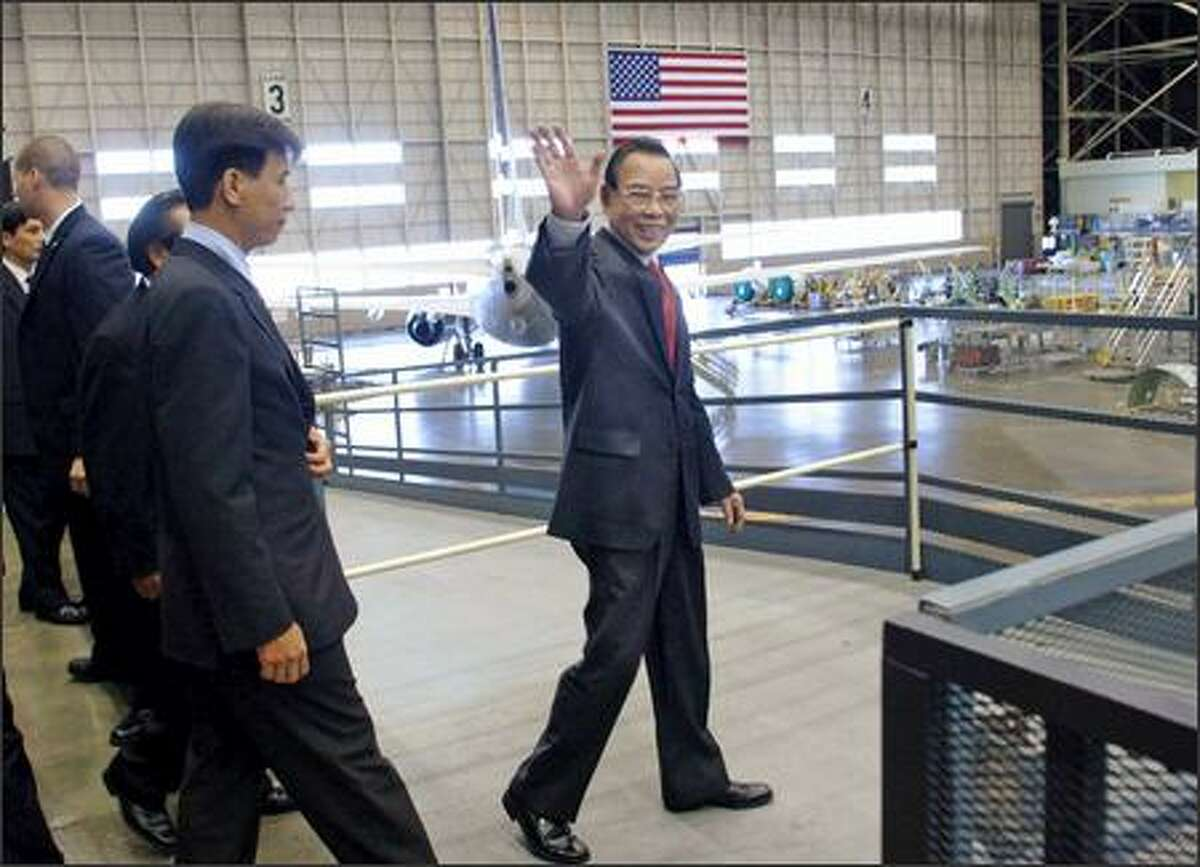 Vietnamese Prime Minister Phan Van Khai tours the Boeing 737 assembly plant in Renton. He was there for the signing ceremony on a deal for Vietnam Airlines to buy four of Boeing's new 787 jetliners.