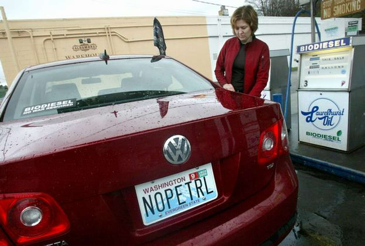 In this January 2006 file photo, Heidi Hynes fills up her new Volkswagen with 99% biodiesel at Laurelhurst Oil in Seattle.