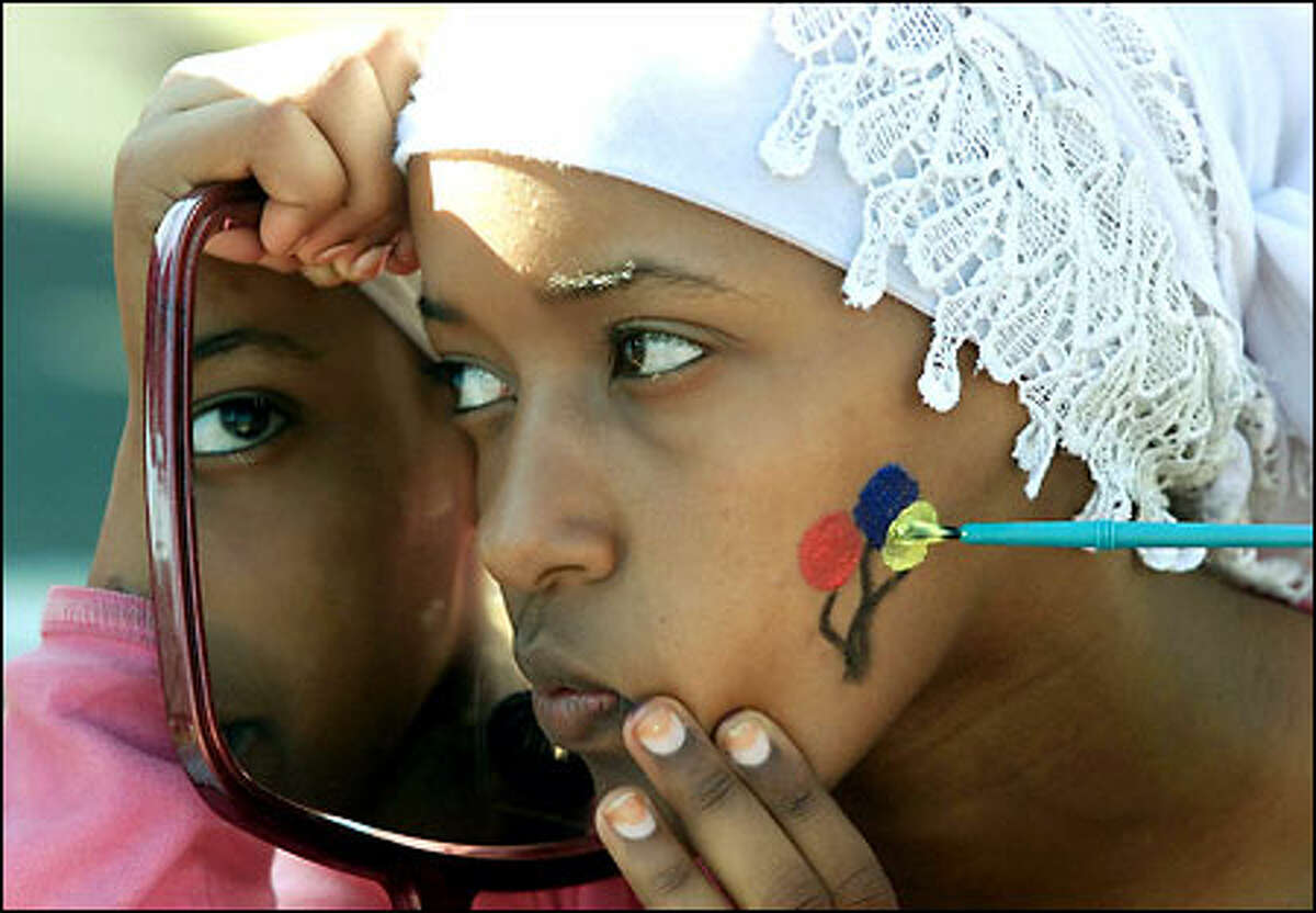 Chaltu Abdela, 13, watches in a mirror as she has her face painted at the Southeast Family center in Seattle for Juneteenth, a day commemorating the end of slavery. On June 19, 1865, Union soldiers under Gen. Gordon Granger arrived in Galveston, Texas, and announced that the Civil War was over, thereby freeing slaves.