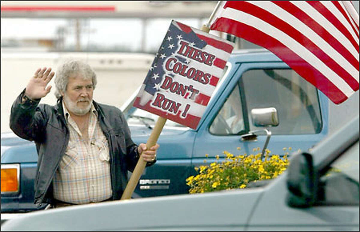 Andy Stevens shows his true colors at the intersection of Commercial and 12th avenues in Anacortes.