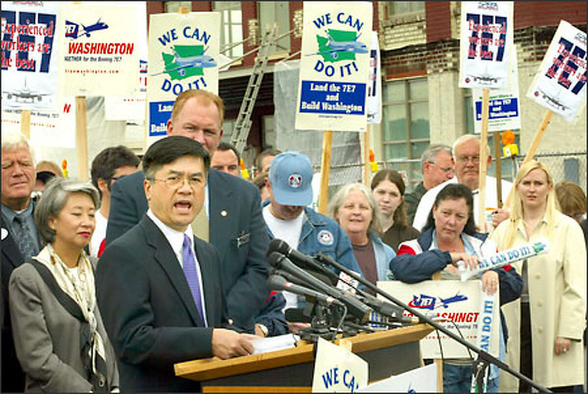 Gov. Gary Locke rallies state and union leaders at King County International Airport.