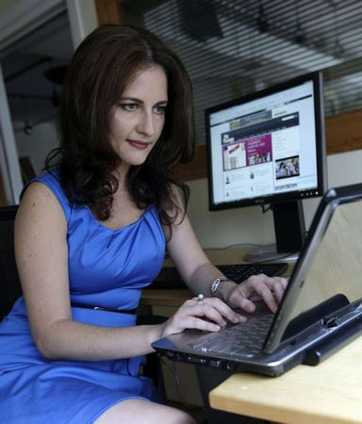 In this photo taken June 12, 2009, Yuli Ziv, president and co-founder of My It Things, is shown in her office in New York. (AP Photo/Richard Drew)