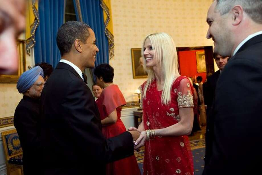 In this handout image provided by the White House, President Barack Obama greets Michaele Salahi and Tareq Salahi at a state dinner in the State Dining Room of the White House on Nov. 24, 2009 in Washington. Photo: Getty Images / Getty Images