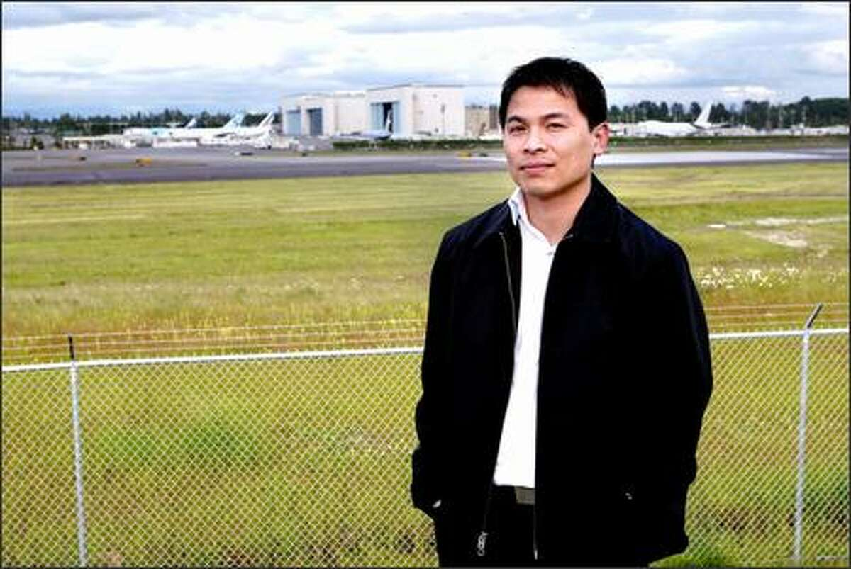 Tien Bui, who came to the U.S. as a refugee from Vietnam, has had to turn down new postings at Boeing while he awaits citizenship.