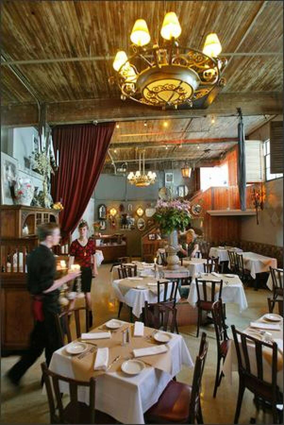 The dining room offers funky charm enhanced by an ornate chandelier, a huge sideboard and a vintage fountain.
