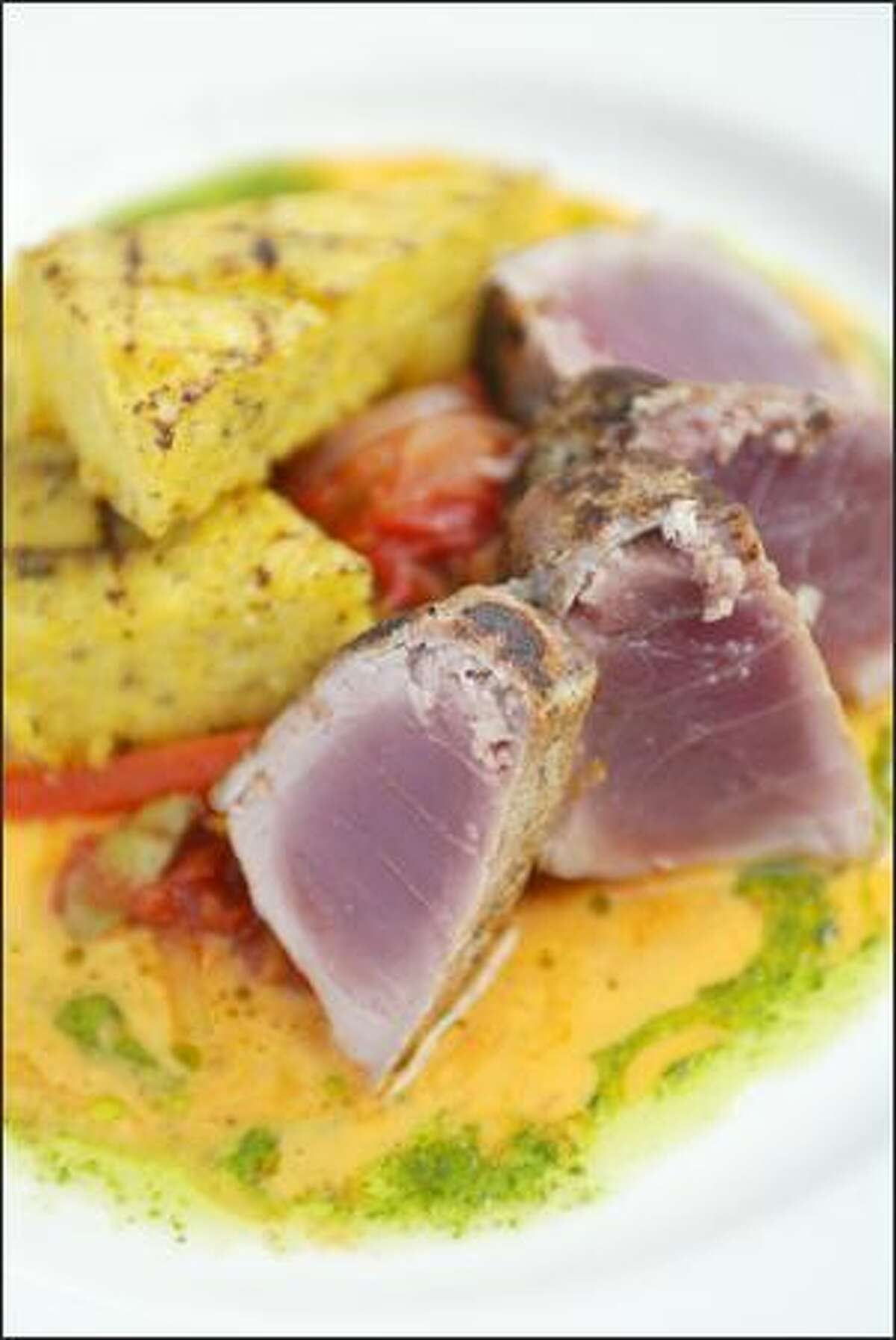 """""""Tonno Di Ahi Peperonata"""" features seared rare tuna, creamy polenta and a mix of tomatoes, sweet bell peppers and olives."""