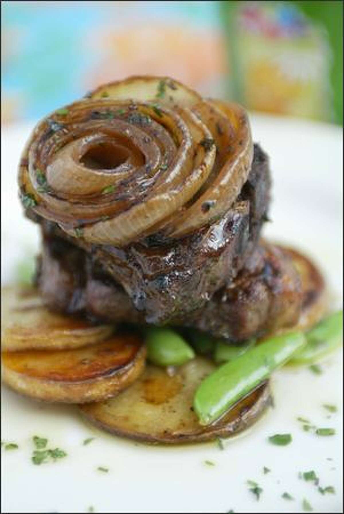 """""""Agnello"""" is grilled lamb porterhouse in lemon-oregano marinade, with caramelized spring onions and sugar snap peas."""