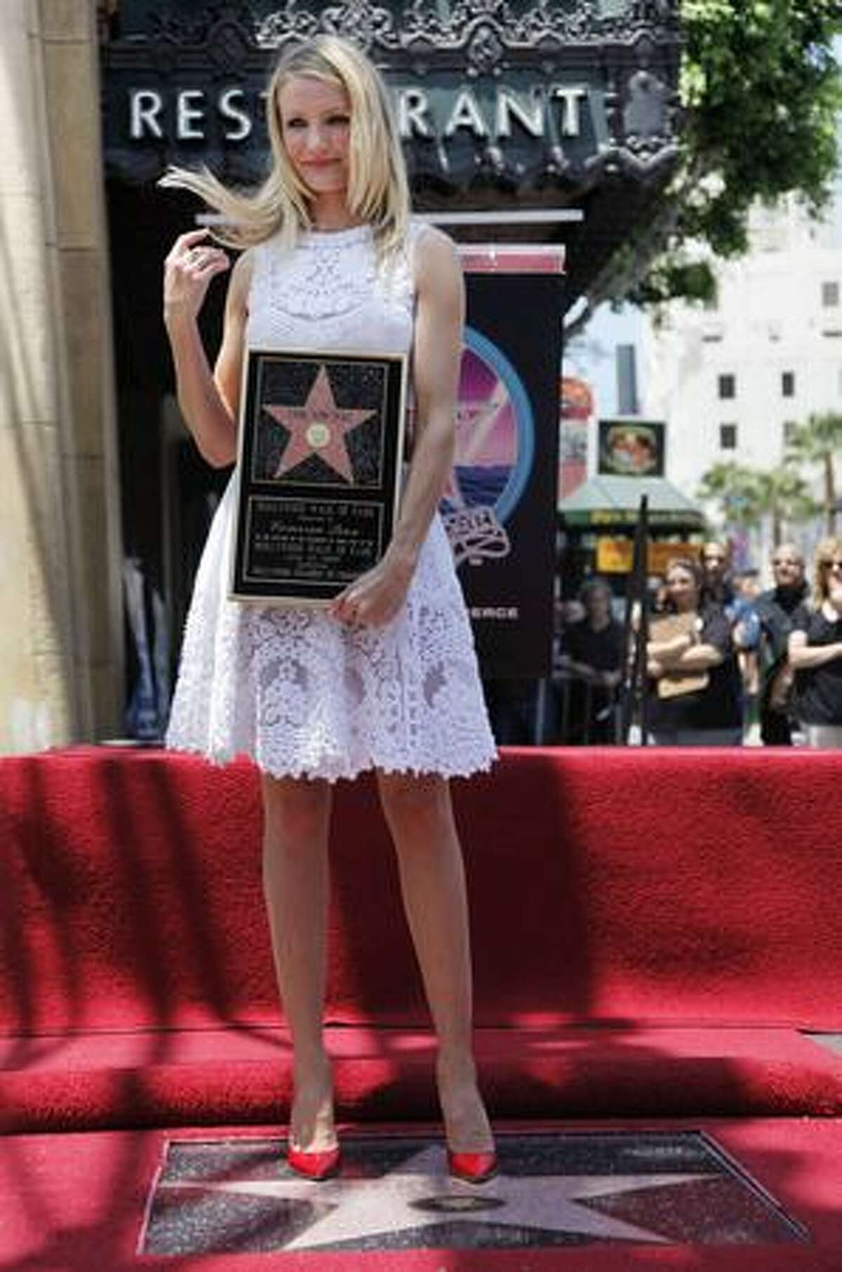 Actress Cameron Diaz poses during a ceremony honoring her with a star on the Hollywood Walk of Fame Monday in Los Angeles, four days before the premiere of her latest film,