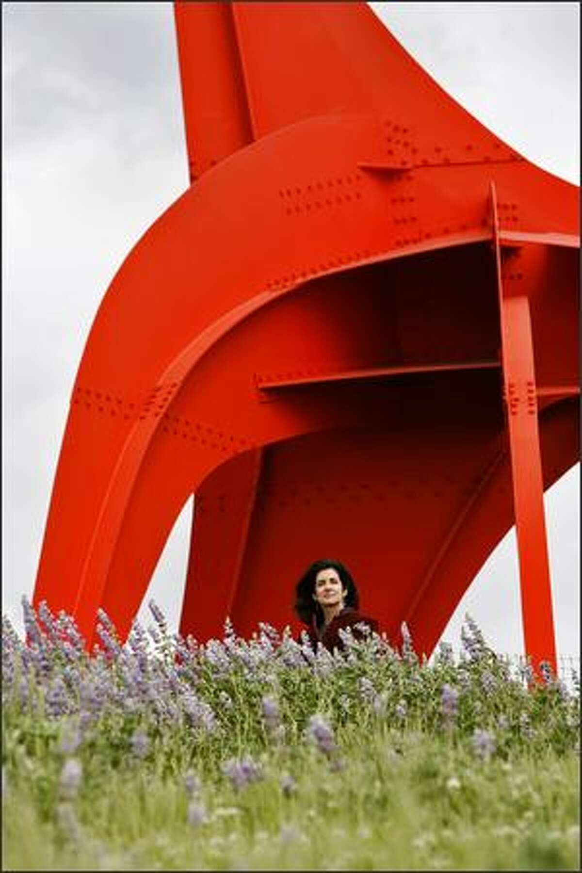 """Blue Balliett stands in front of Alexander Calder's """"Eagle"""" atop a hill overlooking Elliott Bay at the Olympic Sculpture Park."""