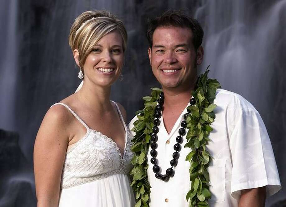 """In this publicity image released by TLC, reality TV stars Jon Gosselin, right, and his wife Kate Gosselin, from the TLC series, """"Jon & Kate Plus 8,"""" are shown in Hawaii. (AP Photo/TLC, Mark Arbeit) Photo: Associated Press / Associated Press"""